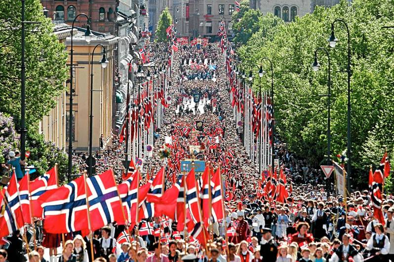 Norwegians marching in the street while singing