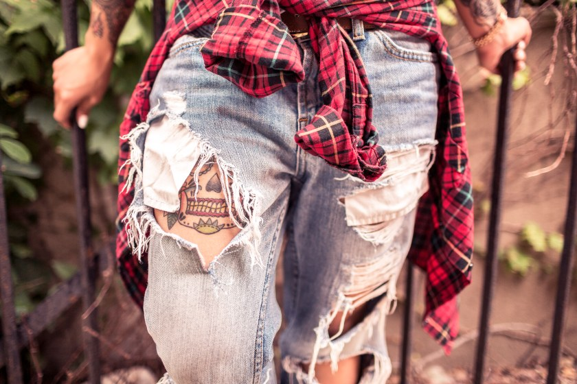 ripped jeans and tattoos