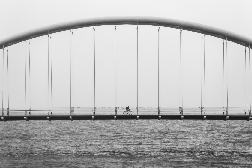 Push biking on bridge